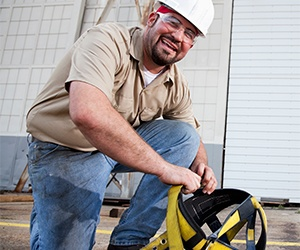 Worker going through fall protection inspection training